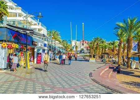EILAT ISRAEL - FEBRUARY 23 2016: The promenade of the resort is a dream for children with a lot of toy shops ice cream cafes and the amusement park on February 23 in Eilat.