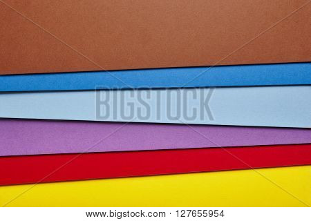 Colored cardboards background in many colors. Copy space. Horizontal