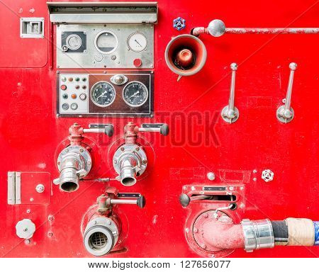 dirt old fire truck and close up equipments.