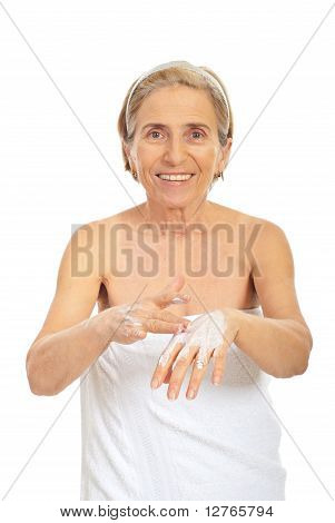 Smiling Senior Woman Apply Cream On Hands