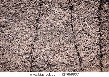 black cracked asphalt road background texture close-up