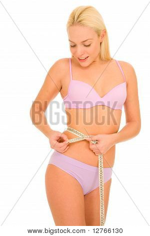 woman measuring the waist with a tape