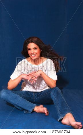Portrait of a beautiful woman sitting indoor