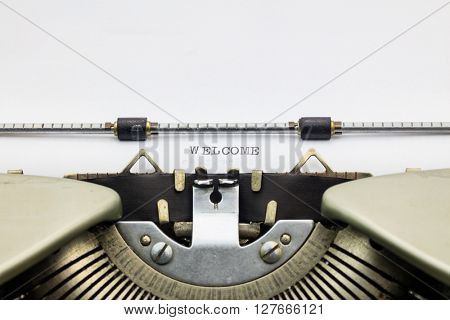 Printed word Welcome on sheet of typewriter