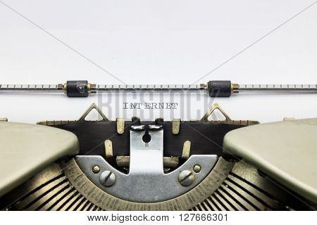 Close-up of word Internet on typewriter sheet
