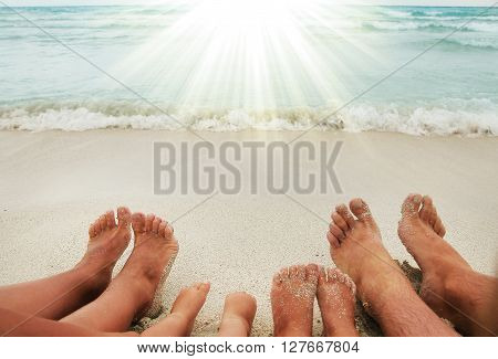 a Family feet on the sand on the beach