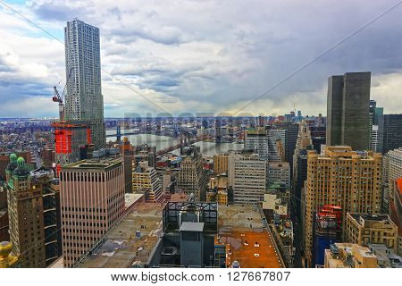New York, USA - April 24, 2015: Aerial view on Lower Manhattan and Bridges New York USA Brooklyn Bridge and Manhattan Bridge over East River. Skyline with skyscrapers. Brooklyn Heights on the background.