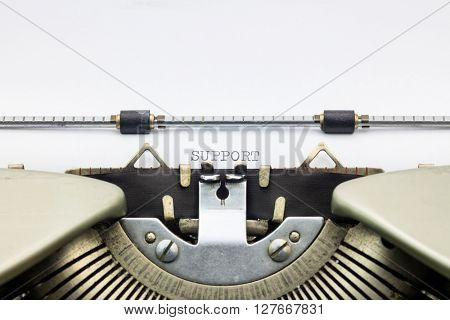 Close-up of word Support  on typewriter sheet
