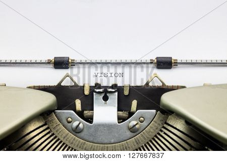 Close-up of word Vision on typewriter sheet