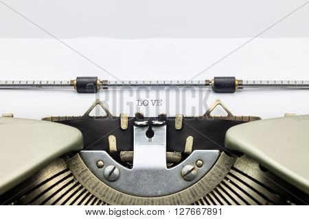 Close-up of word Love  on typewriter sheet