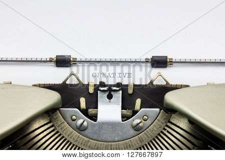 Close-up of word Creative  on typewriter sheet