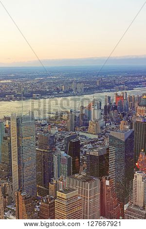 New York, USA - April 24, 2015: Aerial view from Observatory deck in the Empire State Building on Midtown Manhattan of New York USA. Hudson river and New Jersey on the background.