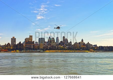 Helicopter Flying Over East River