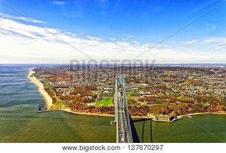 Aerial view of Verrazano-Narrows Bridge over the Narrows. It connects Brooklyn and Staten Island. Narrows is strait connecting Upper Bay with Lower Bay. View on Fort Wadsworth Bunker and Light in Staten Island