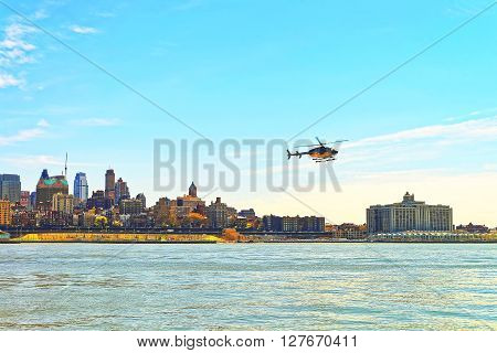 Helicopter Flying Above East River