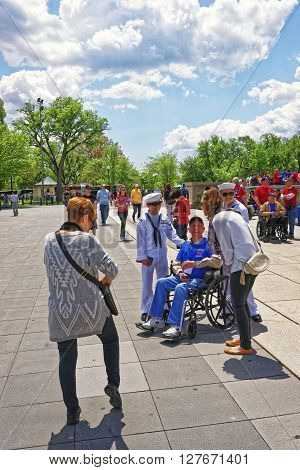 War Veterans And Tourists At Lincoln Memorial In Washington Dc