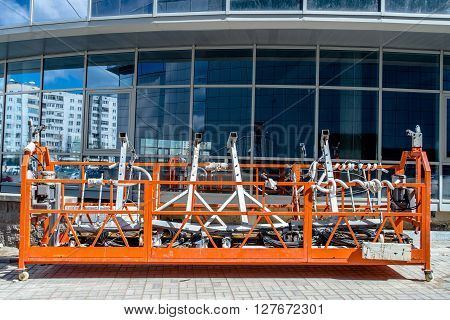 construction cradle against the background of building under construction