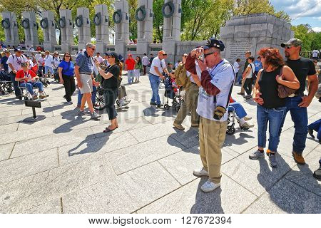 War Veterans At Pillars In National World War 2 Memorial