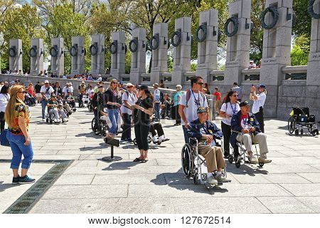 War Veterans Near Pillars In National World War 2 Memorial