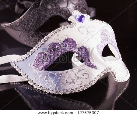 Venetian masks over black background horizontal image
