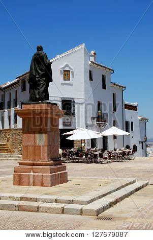 ANTEQUERA, SPAIN - JULY 1, 2008 - Statue of Pedro Espinosa in the Plaza de Santa Maria with a pavement cafe and the giants arch to the rear Antequera Malaga Province Andalucia Spain Western Europe, July 1, 2008.