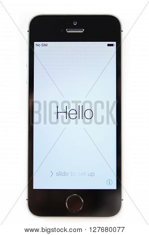 PARIS FRANCE - APR 21 2016: First start of the new iPhone SE with Hello message on screen - the new phone combines the updated processor 4K rear camera touch id retina display