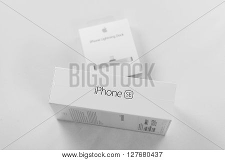 PARIS FRANCE - APR 21 2016: Packaging box of the new Apple iPhone SE combining the updated processor 4K rear camera touch id retina display and new Docking Station for iphone