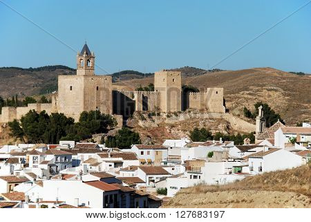 View of the castle fortress with townhouses in the foreground Antequera Malaga Province Andalucia Spain Western Europe.