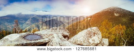 View of the panoramic valley which glow by sunlight. Dramatic scene and picturesque picture. Location place Carpathian, Ukraine, Europe. Beauty world. Retro and vintage style. Instagram toning effect