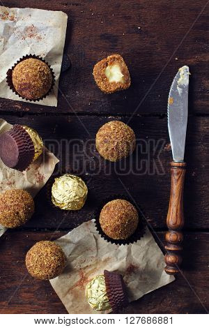 Sweet homemade pralines frm above on the wooden background selective focus