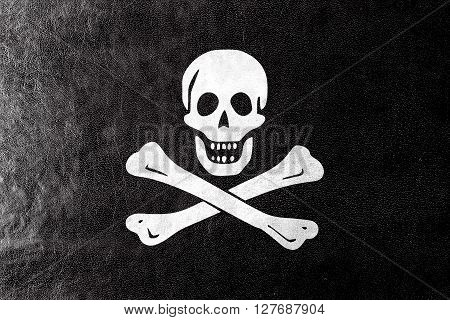 The Traditional Jolly Roger Of Piracy Flag, Painted On Leather Texture