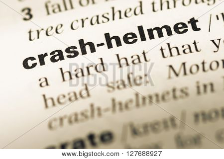 Close Up Of Old English Dictionary Page With Word Crash Helmet.