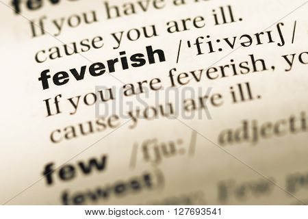 Close Up Of Old English Dictionary Page With Word Feverish.