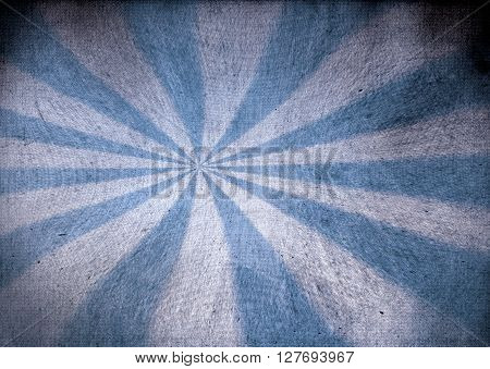 A faded blue and white grunge starburst