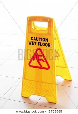 Wet Floor Caution Sign on the Floor