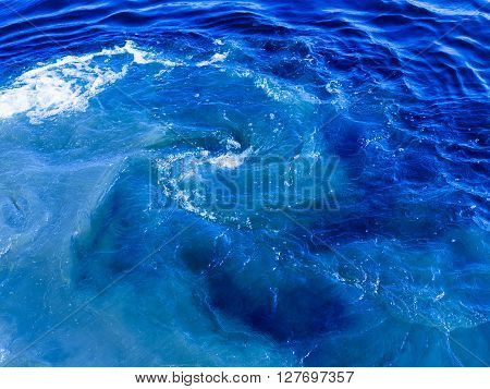 beautiful clear blue water flowing and bubbling and splashing splashing splashes drops and spirals and foams