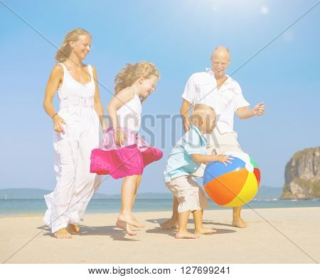 Family playing on the beach.