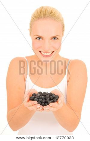 Woman with blueberries in hand