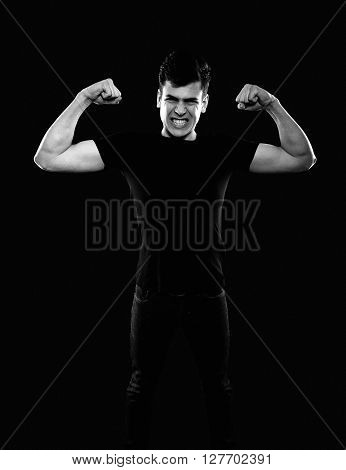 young man showing his muscles in black and white