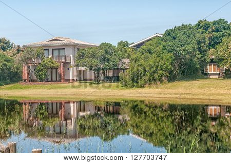 NATURES VALLEY SOUTH AFRICA - MARCH 2 2016: Houses next to the overflowing lagoon at the mouth of the Groot River in the town of Natures Valley