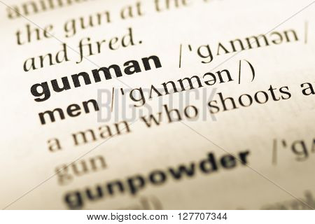 Close Up Of Old English Dictionary Page With Word Gunman.