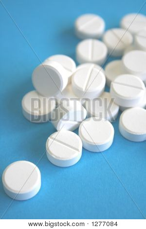 White Pills On A Blue Background