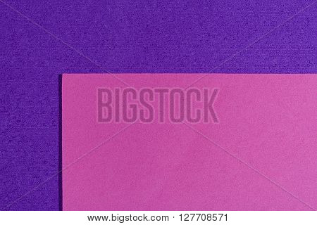 Eva foam ethylene vinyl acetate smooth pink surface on purple sponge plush background