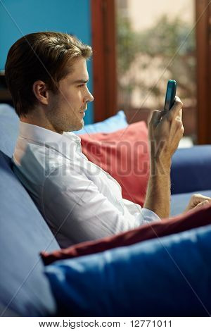 Man Typing Sms On Cellphone