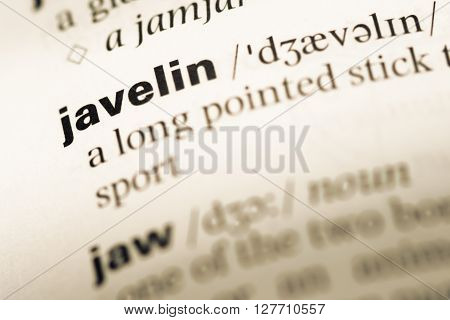 Close Up Of Old English Dictionary Page With Word Javelin.
