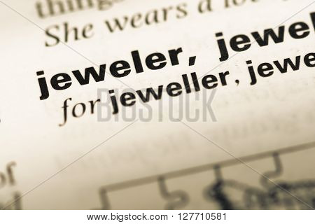 Close Up Of Old English Dictionary Page With Word Jeweler.