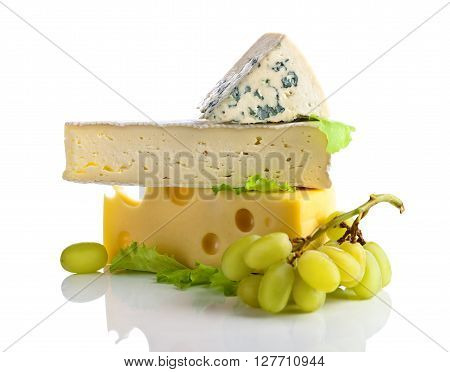 Cheeses And Grapes Isolated On White