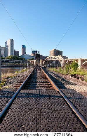 robert street multiple arch bridge and railroad tracks leading to vertical lift bridge spanning mississippi river in downtown saint paul Minnesota