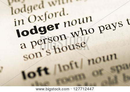 Close Up Of Old English Dictionary Page With Word Lodger.