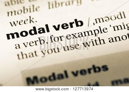 Close Up Of Old English Dictionary Page With Word Modal Verb.